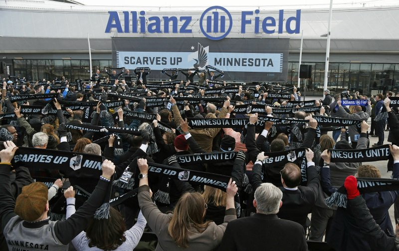 In this March 18, 2019 photo, soccer supporters wave scarves as Minnesota United FC Loons held a scarf raising ceremony in advance of the MSL soccer team's home opener April 13 against New York City FC in the Allianz Field stadium in St. (AP Photo/Jim Mone)