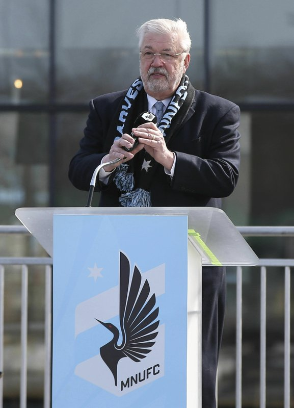 In this March 18, 2019, photo, Minnesota United FC Loons managing partner, Bill McGuire, addresses soccer supporters at a scarf raising ceremony in advance of the MSL soccer team's home opener April 13 against New York City FC in the new privately -funded Allianz Field stadium in St. (AP Photo/Jim Mone)
