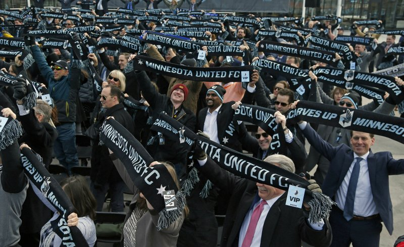 In this March 18, 2019, photo, soccer supporters wave scarves as Minnesota United FC Loons held a scarf raising ceremony in advance of the MLS soccer team's home opener April 13 against New York City FC in the new Allianz Field stadium in St. (AP Photo/Jim Mone)