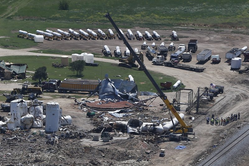 FILE  This April 2013, file photo, shows damage from the West, Texas, fertilizer plant explosion as seen from helicopters as President Barack Obama traveled to a memorial in Waco, Texas. (AP Photo/Charles Dharapak, File)