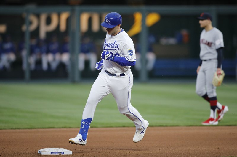 Kansas City Royals' Ryan O'Hearn (66) runs past Cleveland Indians second baseman Brad Miller (17) as he rounds the bases following a solo home run in the fourth inning of a baseball game at Kauffman Stadium in Kansas City, Mo. (AP Photo/Colin E. Braley)