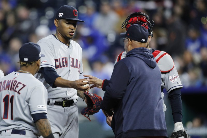 As Cleveland Indians' Jose Ramirez (11) looks on, pitcher Jefry Rodriguez, second from left, hands the ball to manager Terry Francona, front right, as Rodriguez e is taken out of a baseball game in the sixth inning against the Kansas City Royals in Kansas City, Mo. (AP Photo/Colin E. Braley)