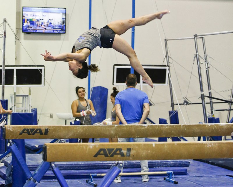 In this Thursday, April 11, 2019, photo, UCLA gymnast Katelyn Ohashi trains with the University of California Bruins gymnastics team in Los Angeles. (AP Photo/Damian Dovarganes)