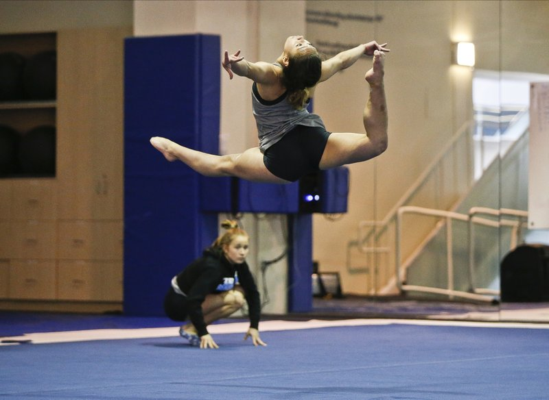 In this Thursday, April 11, 2019, photo, UCLA gymnast Katelyn Ohashi trains on the floor with the University of California Bruins gymnastics team in Los Angeles. (AP Photo/Damian Dovarganes)