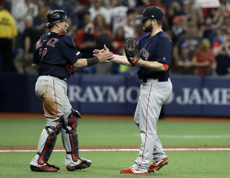 Boston Red Sox relief pitcher Ryan Brasier, right, and catcher Christian Vazquez celebrate after closing out the Tampa Bay Rays during the ninth inning of a baseball game Friday, April 19, 2019, in St. (AP Photo/Chris O'Meara)