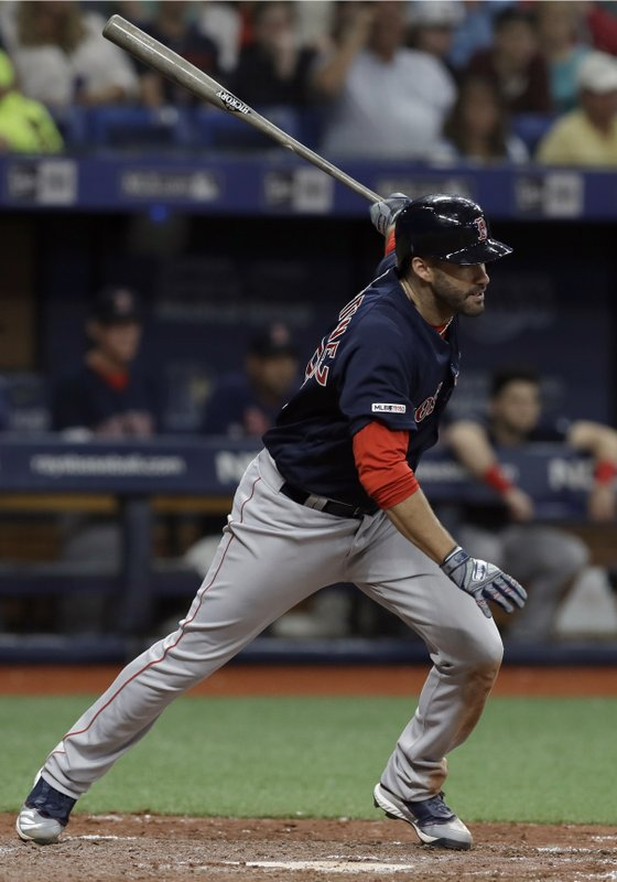 Boston Red Sox's J.D. Martinez lines an RBI-single off Tampa Bay Rays relief pitcher Wilmer Font during the sixth inning of a baseball game Friday, April 19, 2019, in St. (AP Photo/Chris O'Meara)