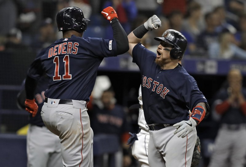 Boston Red Sox's Christian Vazquez, right, celebrates his two-run home run off Tampa Bay Rays relief pitcher Ryan Yarbrough with Rafael Devers during the fifth inning of a baseball game Friday, April 19, 2019, in St. (AP Photo/Chris O'Meara)