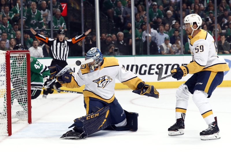 Nashville Predators goaltender Pekka Rinne (35) slaps at a Dallas Stars shot with his stick as Stars' Alexander Radulov (47) and Predators' Roman Josi (59) watch in the first period of Game 6 in an NHL hockey first-round playoff series in Dallas, Monday, April 22, 2019. (AP Photo/Tony Gutierrez)