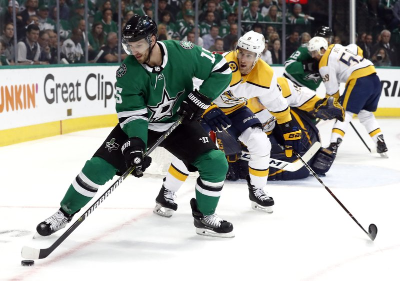 Dallas Stars left wing Blake Comeau (15) controls the puck in front of Nashville Predators' Kyle Turris (8) in the first period of Game 6 in an NHL hockey first-round playoff series in Dallas, Monday, April 22, 2019. (AP Photo/Tony Gutierrez)
