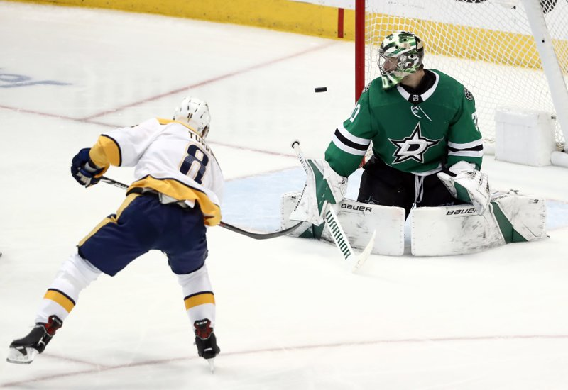Nashville Predators center Kyle Turris (8) has his shot deflected by Dallas Stars' Ben Bishop (30) in the third period of Game 6 in an NHL hockey first-round playoff series in Dallas, Monday, April 22, 2019. (AP Photo/Tony Gutierrez)