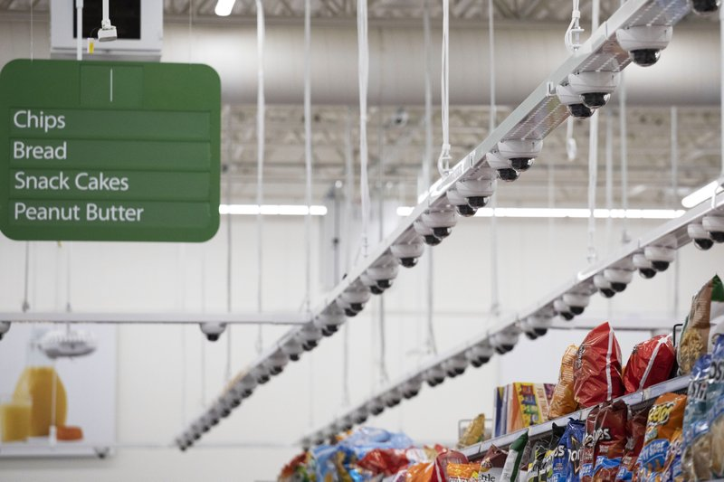 Dozens of cameras hang above an aisle at a Walmart Neighborhood Market, Wednesday, April 24, 2019, in Levittown, N. (AP Photo/Mark Lennihan)