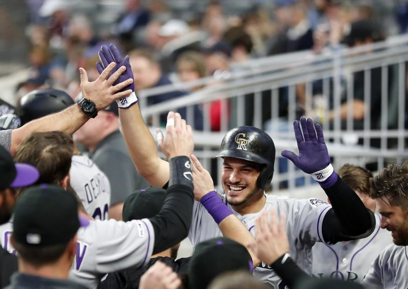 Colorado Rockies' Nolan Arenado celebrates after hitting a solo home run in the fourth inning of a baseball game against the Atlanta Braves, Friday, April 26, 2019, in Atlanta.(AP Photo/John Bazemore)