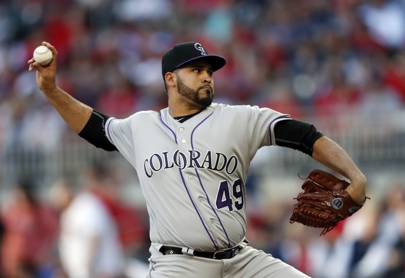 Colorado Rockies starting pitcher Antonio Senzatela works against the Atlanta Braves in the first inning of a baseball game Friday, April 26, 2019, in Atlanta.(AP Photo/John Bazemore)