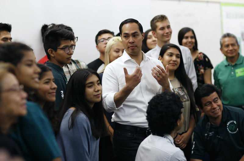 Former Housing and Urban Development Secretary and Democratic presidential candidate Julian Castro, center right, speaks with students at the Hispanic Student Union at Rancho High School during a campaign stop Friday, April 26, 2019, in Las Vegas. (AP Photo/John Locher)