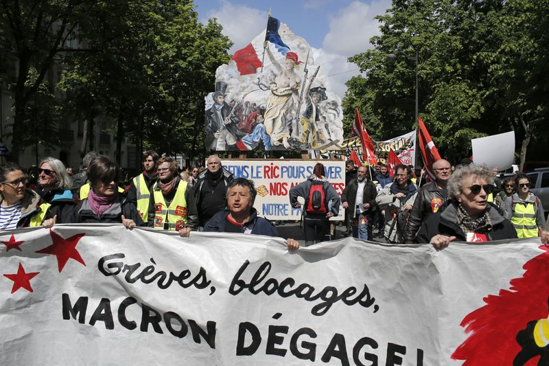 Yellow Vest demonstrators march in Paris, during another protest Saturday April 27, 2019. Yellow vest protesters remain a force in French politics despite ups and downs in the five months after their movement started. (AP Photo/Rafael Yaghobzadeh)
