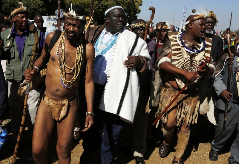 People attend Freedom Day celebrations in Kwa-Thema Township, near Johannesburg, Saturday April 27, 2019. (AP Photo/Denis Farrell)