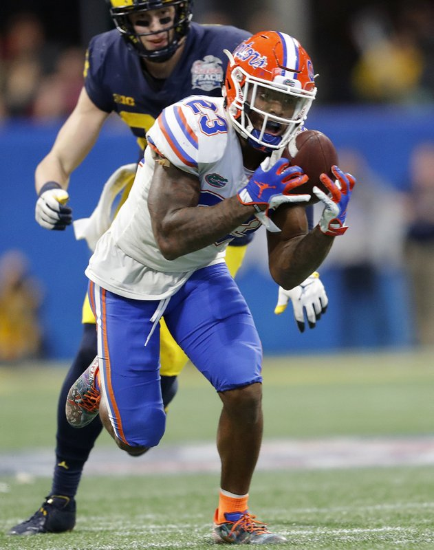 FILE - In this Dec. 29, 2018, file photo, Florida defensive back Chauncey Gardner-Johnson (23) makes the catch for an interception against Michigan during the second half of the Peach Bowl NCAA college football game, in Atlanta. (AP Photo/John Bazemore, File)
