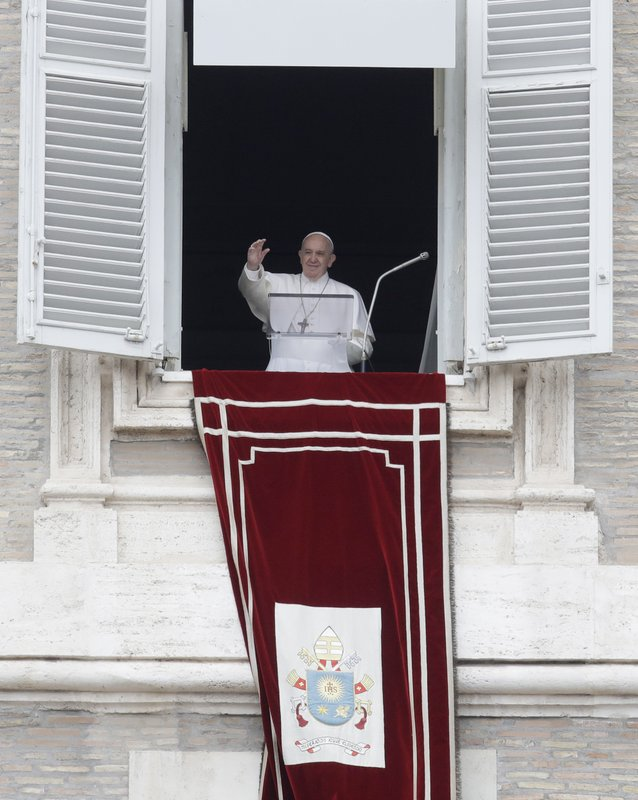 Pope Francis waves to the crowd during the Regina Coeli noon prayer from the window of his studio overlooking St. (AP Photo/Alessandra Tarantino)