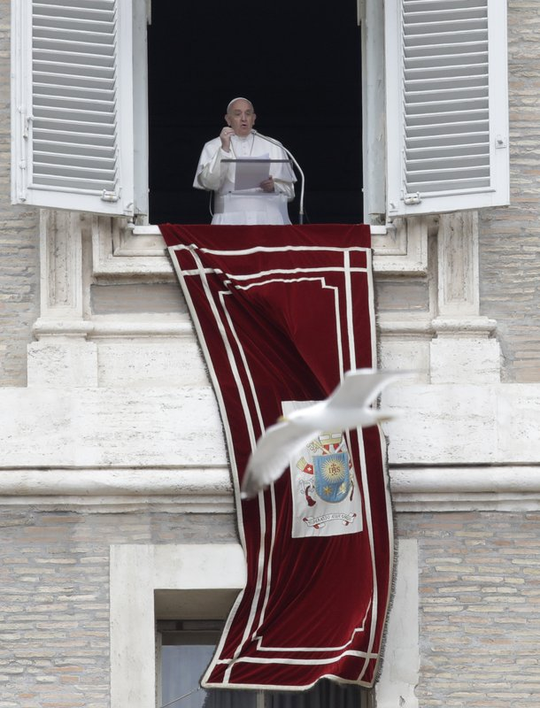 Pope Francis delivers his speech during the Regina Coeli noon prayer from the window of his studio overlooking St. (AP Photo/Alessandra Tarantino)