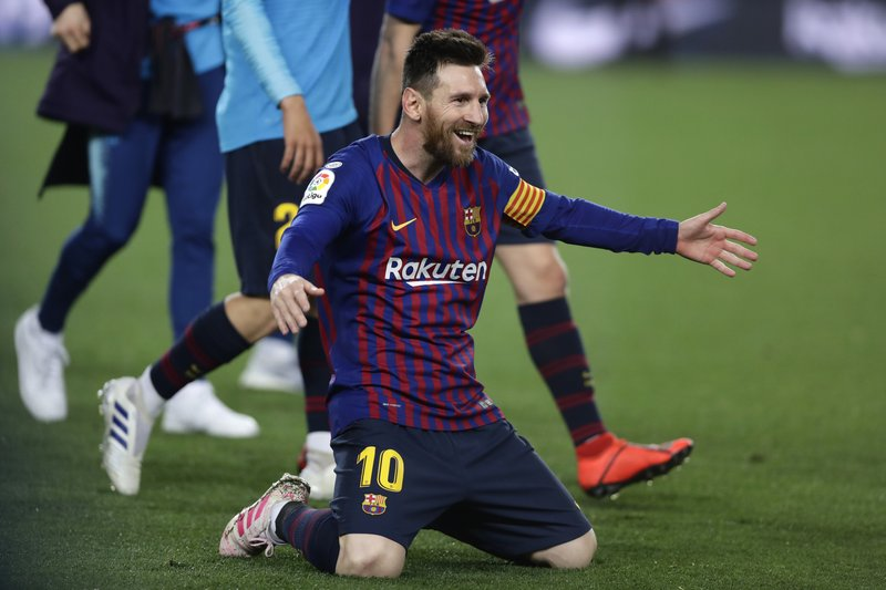 Barcelona forward Lionel Messi celebrates winning the Spanish League title, at the end of the Spanish La Liga soccer match between FC Barcelona and Levante at the Camp Nou stadium in Barcelona, Spain, Saturday, April 27, 2019. (AP Photo/Manu Fernandez)