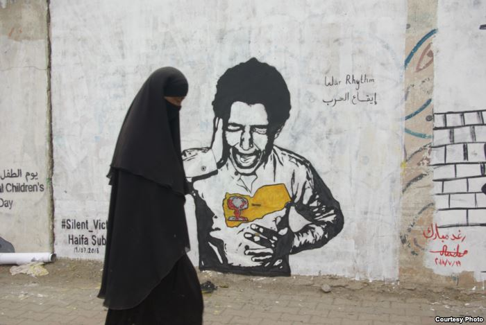 This mural in Sanaa drawn by Yemeni artist Haifa Subay depicts a boy screamin
