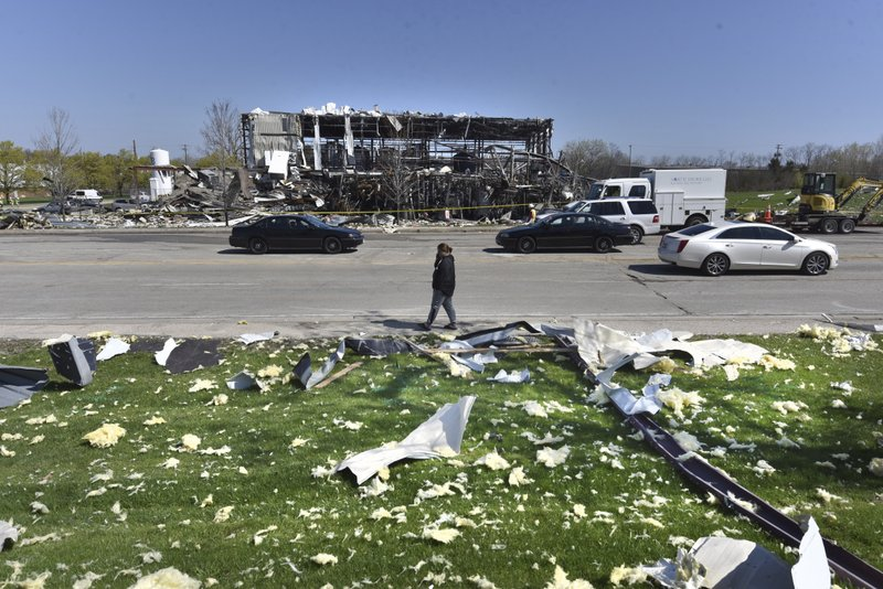 Debris is scattered across the street at the scene of an explosion at AB Specialty Silicones on Sunset Ave. and Northwestern Ave. on the border between Gurnee, Ill., and Waukegan. The explosion happened Friday night. (John Starks/Daily Herald via AP)