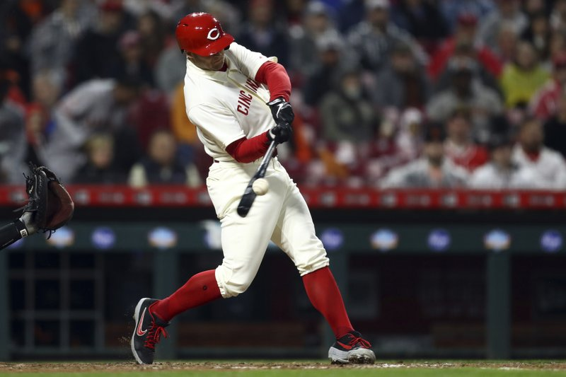 Cincinnati Reds' Nick Senzel hits a home run, his first in the majors, during the fifth inning of the team's baseball game against the San Francisco Giants, Saturday, May 4, 2019, in Cincinnati. (AP Photo/Aaron Doster)