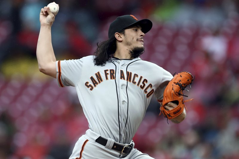 San Francisco Giants' Dereck Rodriguez throws during the first inning of the team's baseball game against the Cincinnati Reds, Saturday, May 4, 2019, in Cincinnati. (AP Photo/Aaron Doster)