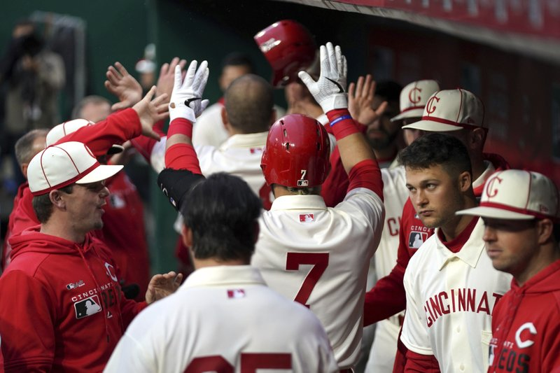 Cincinnati Reds' Eugenio Suarez celebrates with teammates after hitting a three-run home run during the second inning of the team's baseball game against the San Francisco Giants, Saturday, May 4, 2019, in Cincinnati. (AP Photo/Aaron Doster)