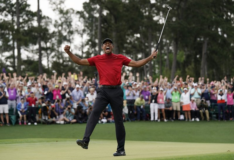 FILE - In this Sunday, April 14, 2019, file photo, Tiger Woods reacts as he wins the Masters golf tournament in Augusta, Ga. (AP Photo/David J. Phillip, File)
