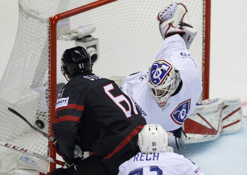 Canada's Mark Stone, left, fails to score past Henri Corentin Buysse of France, right, during the Ice Hockey World Championships group A match between Canada and France at the Steel Arena in Kosice, Slovakia, Thursday, May 16, 2019. (AP Photo/Petr David Josek)