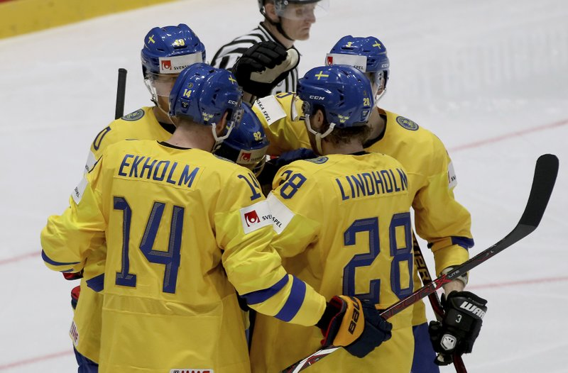 Sweden's players react after scoring during the Ice Hockey World Championships group B match between Sweden and Austria at the Ondrej Nepela Arena in Bratislava, Slovakia, Thursday, May 16, 2019. (AP Photo/Ronald Zak)