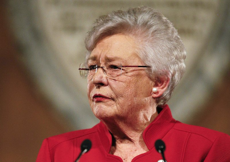 FILE- In this Jan. 9, 2018, file photo, Alabama Gov. Kay Ivey delivers the annual State of the State address at the Capitol in Montgomery, Ala. (AP Photo/Brynn Anderson, File)
