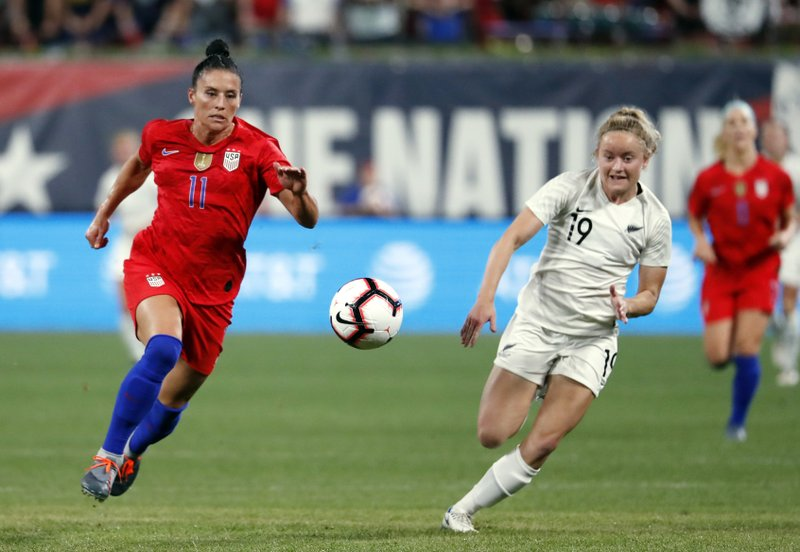United States' Ali Krieger, left, and New Zealand's Paige Stachell chase the ball during the second half of an international friendly soccer match Thursday, May 16, 2019, in St. Louis. The United States won 5-0. (AP Photo/Jeff Roberson)