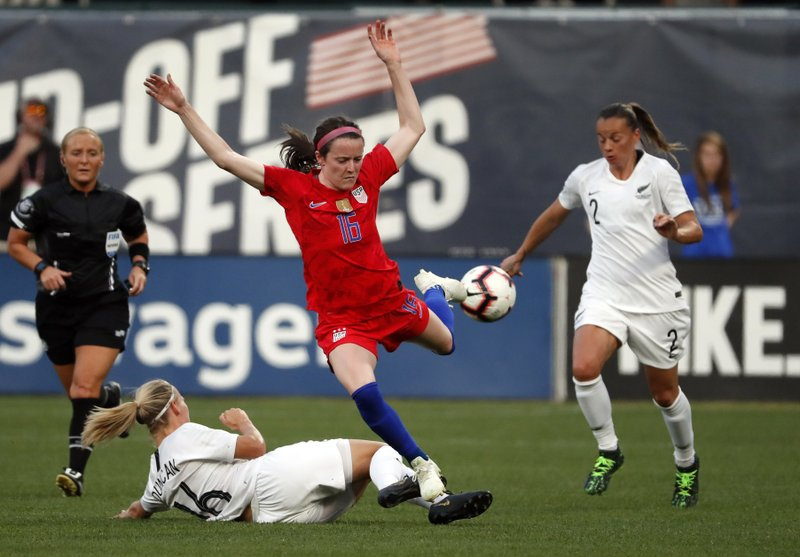 United States' Rose Lavelle, center, chases the ball between New Zealand's Ria Percival (2) and Katie Duncan (16) during the first half of an international friendly soccer match Thursday, May 16, 2019, in St. Louis. (AP Photo/Jeff Roberson)