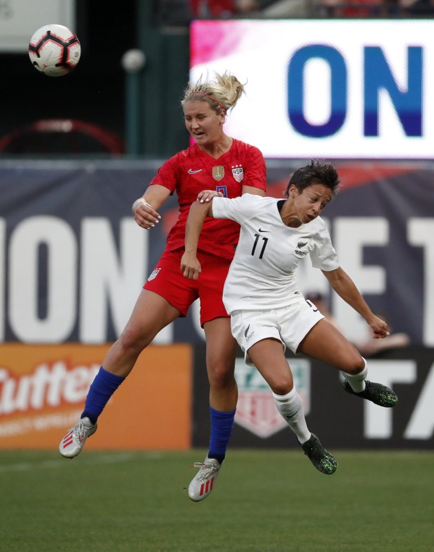 United States' Lindsey Horan and New Zealand's Sarah Gregorius (11) compete for the ball during the first half of an international friendly soccer match Thursday, May 16, 2019, in St. Louis. (AP Photo/Jeff Roberson)