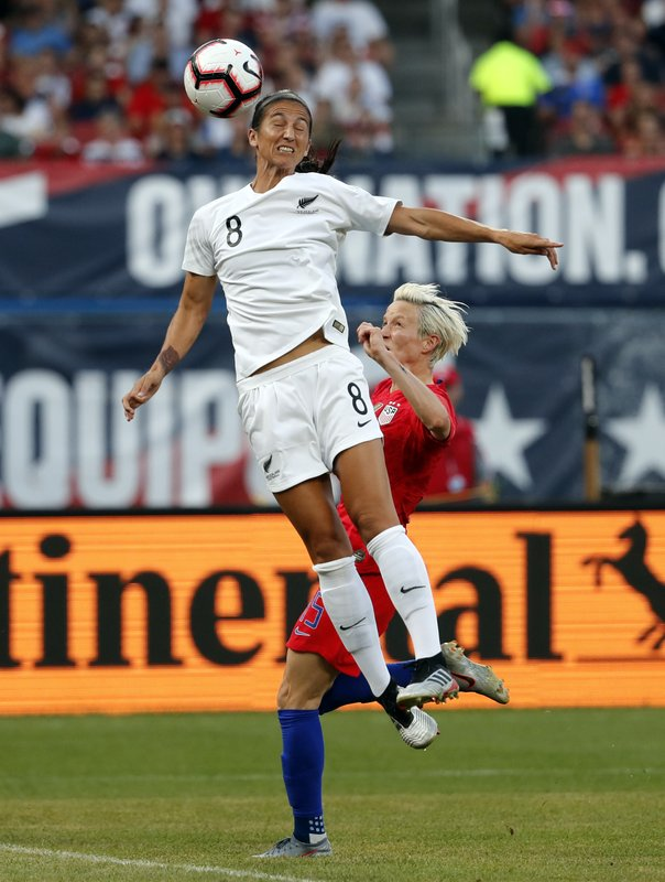 New Zealand's Abby Erceg (8) reaches for the ball as United States' Megan Rapinoe defends during the first half of an international friendly soccer match Thursday, May 16, 2019, in St. Louis. (AP Photo/Jeff Roberson)