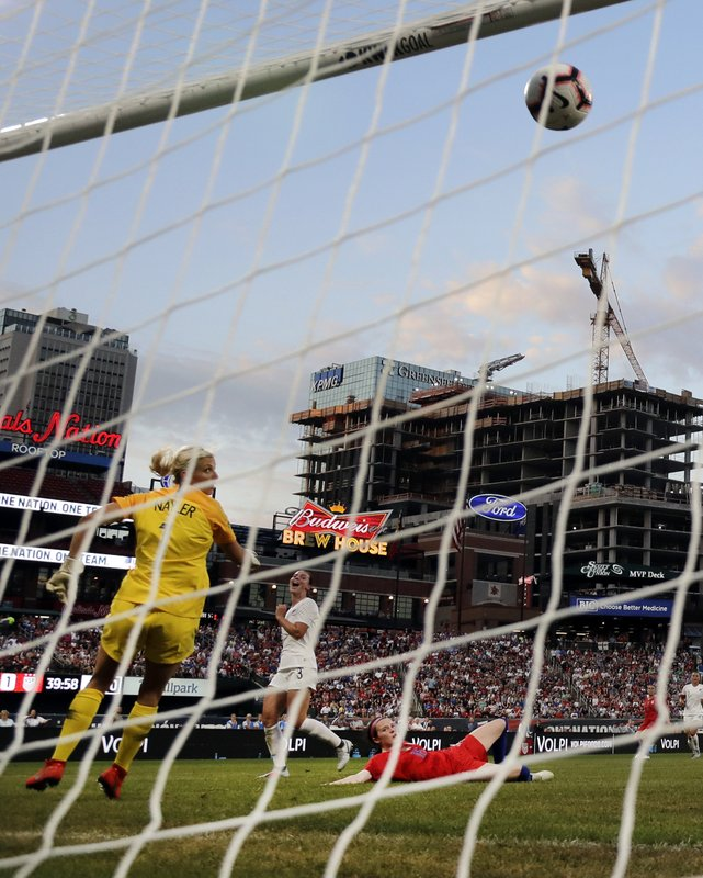 United States' Rose Lavelle, bottom right, scores past New Zealand goalkeeper Erin Nayler, left, and Anna Green (3) during the first half of an international friendly soccer match Thursday, May 16, 2019, in St. Louis. (AP Photo/Jeff Roberson)