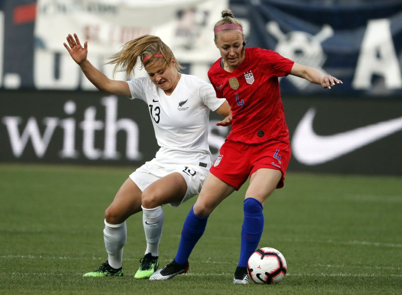 New Zealand's Rosie White (13) and United States' Becky Sauerbrunn (4) battle for the ball during the first half of an international friendly soccer match Thursday, May 16, 2019, in St. Louis. (AP Photo/Jeff Roberson)