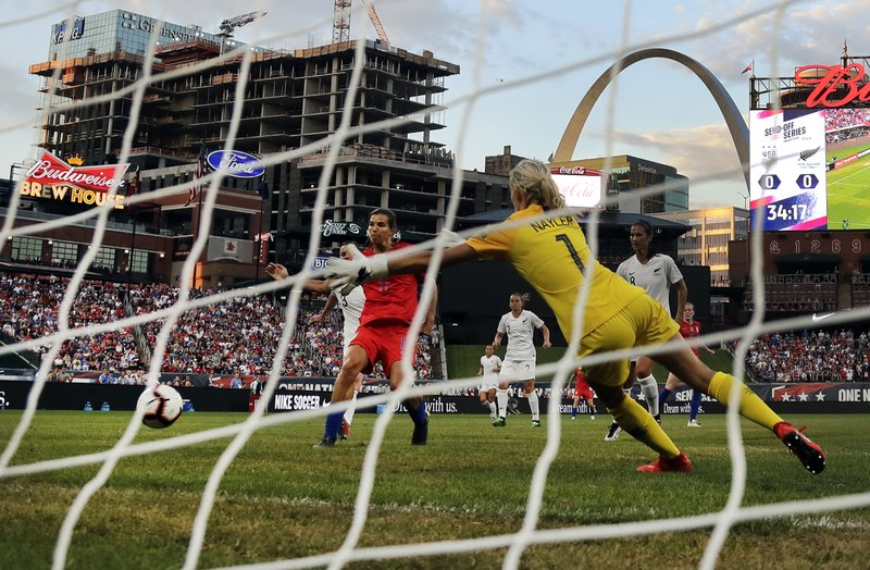 United States forward Tobin Heath, left, scores past New Zealand goalkeeper Erin Nayler during the first half of an international friendly soccer match Thursday, May 16, 2019, in St. Louis. (AP Photo/Jeff Roberson)