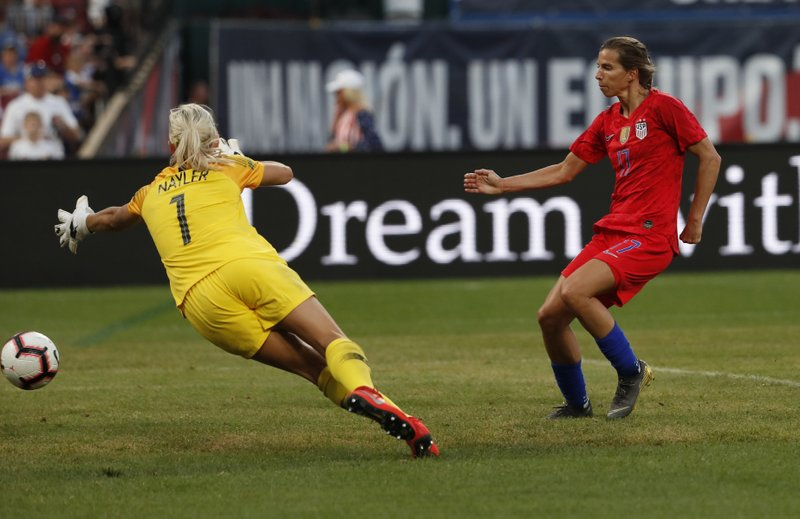 United States forward Tobin Heath, right, scores past New Zealand goalkeeper Erin Nayler during the first half of an international friendly soccer match Thursday, May 16, 2019, in St. Louis. (AP Photo/Jeff Roberson)