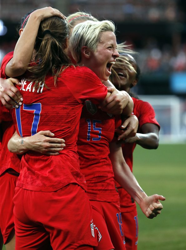 United States' Megan Rapinoe (15) celebrates with teammates including Tobin Heath (17), after a goal by Heath during the first half of an international friendly soccer match against New Zealand on Thursday, May 16, 2019, in St. Louis. (AP Photo/Jeff Roberson)