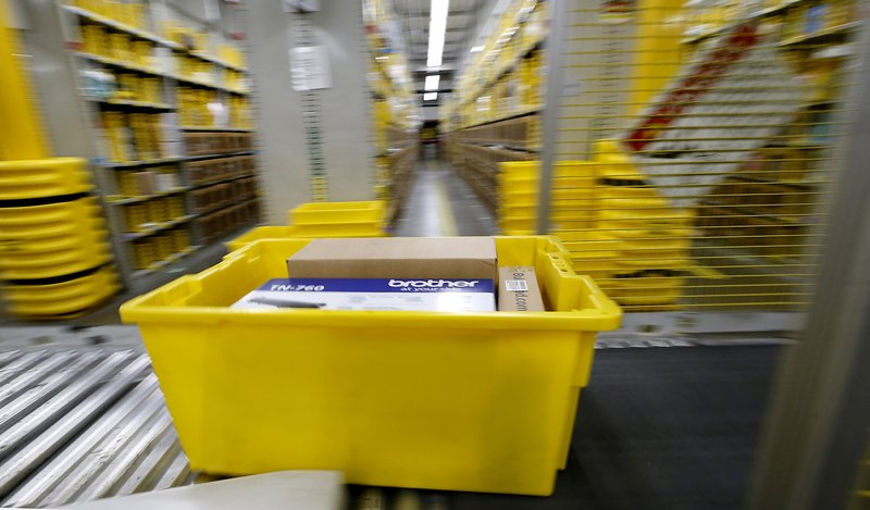 In this Tuesday, May 7, 2019, photo orders are filled at the Amazon Chester Fulfillment Center in Chester, Va. (Alexa Welch Edlund/Richmond Times-Dispatch via AP)