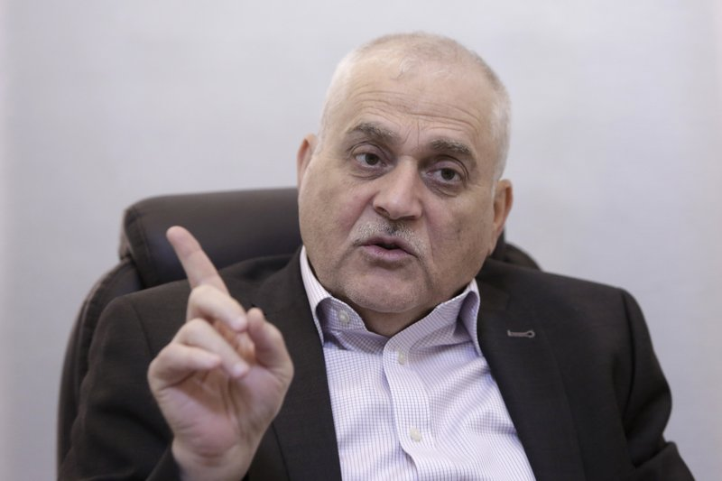 Lebanese Health Minister Jamil Jabak speaks during an interview at his private clinic in a southern suburb of Beirut, Lebanon, Saturday, May 18, 2019. Jabak says he has