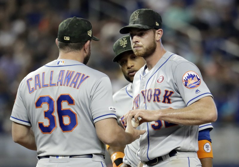 New York Mets starting pitcher Steven Matz, right, hands the ball to manager Mickey Callaway (36) as he is relieved in the fourth inning during a baseball game against the Miami Marlins, Saturday, May 18, 2019, in Miami. (AP Photo/Lynne Sladky)