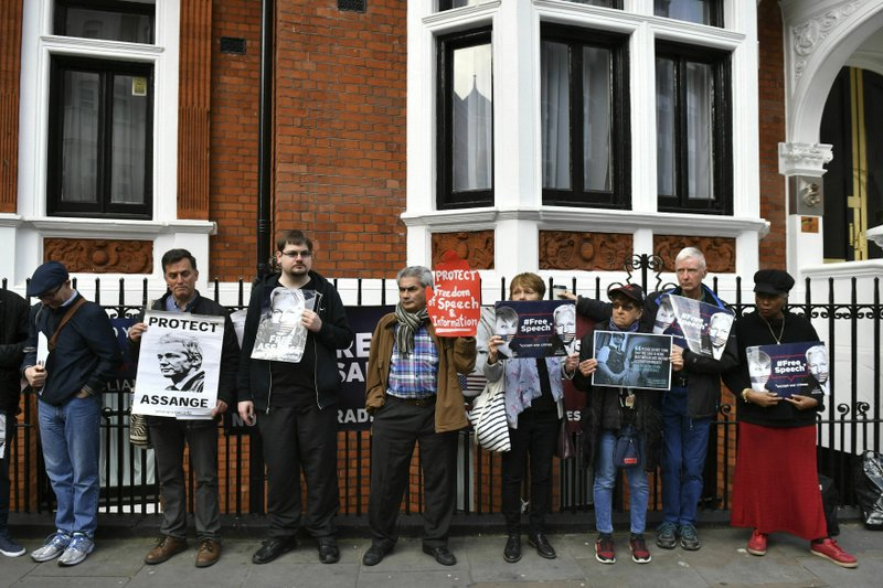 Julian Assange supporters gather outside the Ecuadorian embassy in London, Monday May 20, 2019. Swedish authorities on Monday issued a request for a detention order against WikiLeaks founder Julian Assange, who is now jailed in Britain, a Swedish prosecutor said. (Dominic Lipinski/ PA via AP)