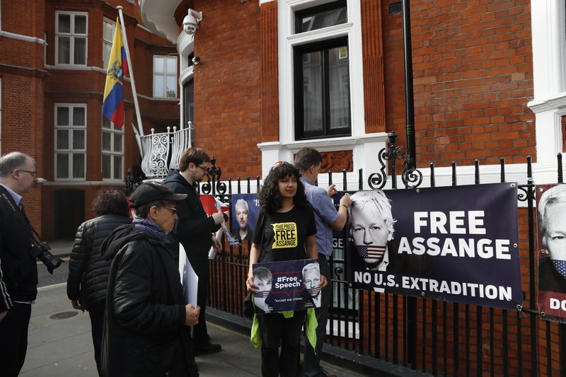 Protesters in support of Wikileaks founder Julian Assange demonstrate outside the Ecuadorian Embassy in London, Monday, May 20, 2019. Swedish authorities on Monday issued a request for a detention order against WikiLeaks founder Julian Assange, who is now jailed in Britain, a Swedish prosecutor said. (AP Photo/Alastair Grant)