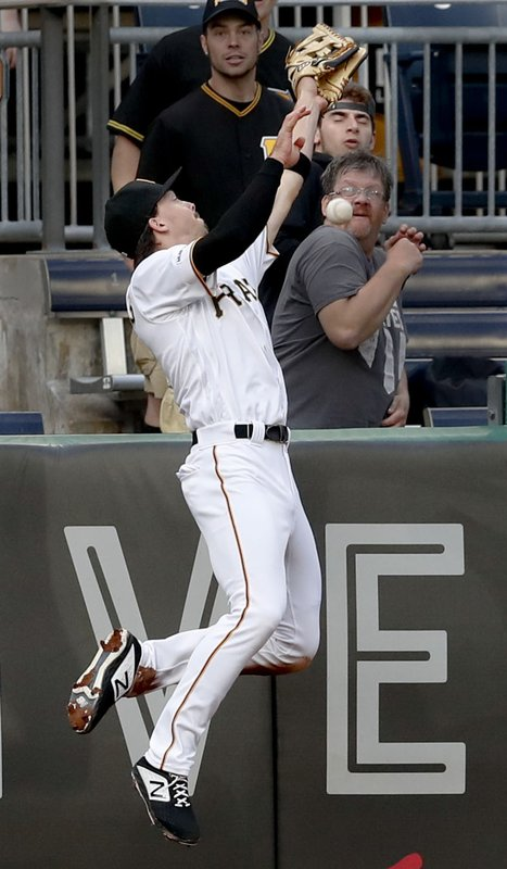 The ball bounces away from Pittsburgh Pirates left fielder Bryan Reynolds as he leaps for a fly ball hit by Colorado Rockies' Trevor Story that went for a solo home run in the third inning of a baseball game Tuesday, May 21, 2019, in Pittsburgh. (AP Photo/Keith Srakocic)