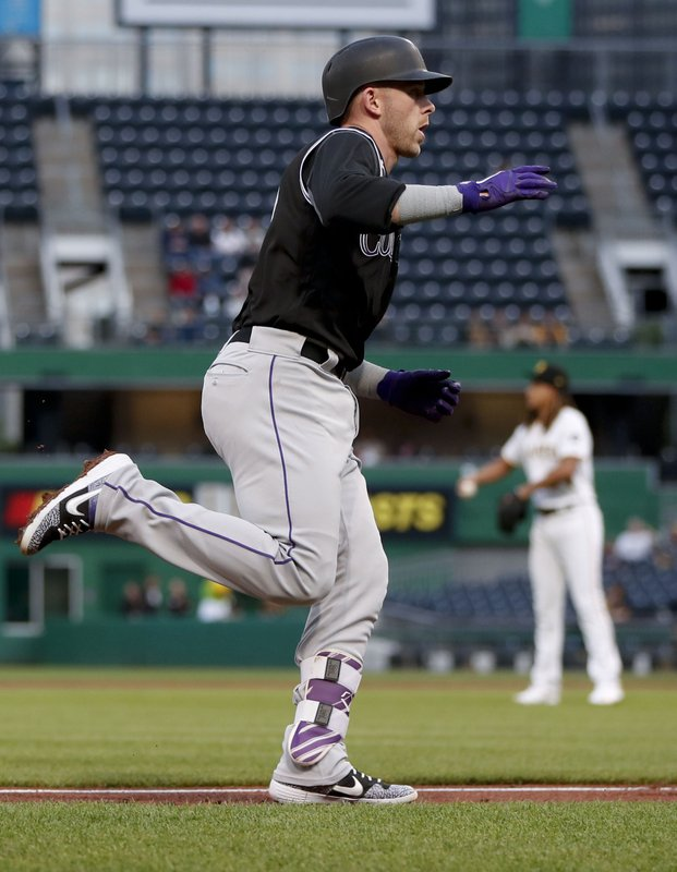 Colorado Rockies' Trevor Story rounds the bases after hitting a solo home run off Pittsburgh Pirates starting pitcher Chris Archer, rear, during the third inning of a baseball game Tuesday, May 21, 2019, in Pittsburgh. (AP Photo/Keith Srakocic)