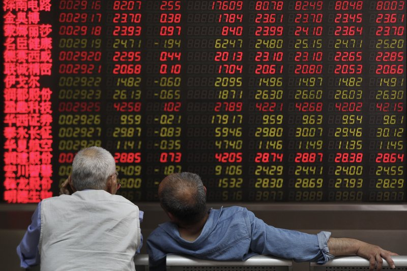 Investors chat as they monitor stock prices at a brokerage house in Beijing, Wednesday, May 22, 2019. Shares edged in Asia on Wednesday after a rebound in technology stocks helped power an overnight rally on Wall Street. (AP Photo/Andy Wong)